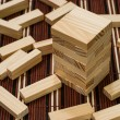 Royalty-Free Stock Photo: Wooden blocks tower and block spread around