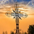 Christian cross on a evening sky background — Stock Photo