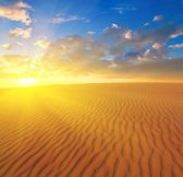 Sunset over a sand desert — Stock Photo