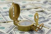 Compass on a heap of dollars — Stock Photo