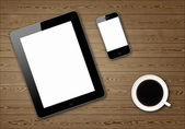 Two tablet pc and coffe cup on a wooden board — Stock Photo