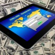 Tablet pc on a dollars background — Stock Photo