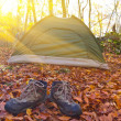 Hiker boots near a tent — Stock Photo