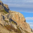 Stock Photo: Precipice of rock on blue sky background