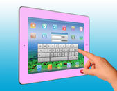 Woman hand point a pink tablet pc — Stock Photo