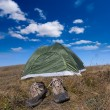 Touristic tent and boots - Stockfoto