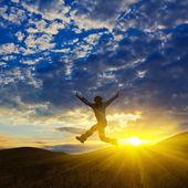 Man lumping on a sunset background — Stock Photo
