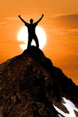 Man silhouette stay on a mount top — Stock Photo