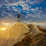 Hiker valking among a mountains — Stock Photo