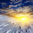 Stock Photo: Evening snowbound plain by sunset