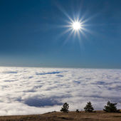 Sparkle sun above a dense clouds — Stock Photo