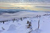 Snowbound hills at the evening — Stockfoto