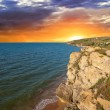 Dramatic sunset over a sea bay — Stock Photo