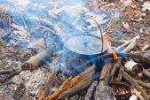 Touristic caldron in a fire — Stock Photo