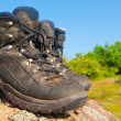Stock Photo: Touristic boots on stone