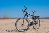 Bicycle on a sand — Stock Photo