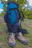Touristic boots and a backpack — Stock Photo