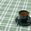 Stock Photo: Cup coffee on table with tablecloth