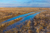 Small blue pond in a steppe — Stock Photo