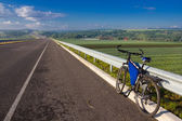 Bicycle on a asphalt road — Stock Photo