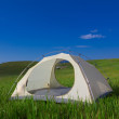 Touristic tent among a green hills — Stock Photo