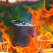 Touristic cauldron in camp fire — Stock Photo #27916329