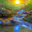 Mountain canyon river in a rays of sun — Stock Photo