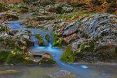 Beautiful blue brook in a mountain canyon — Stock Photo