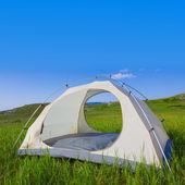 White touristic tent on a green grass — Stock Photo