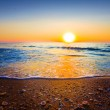 Beautiful sunset over a sea coast — Stock Photo