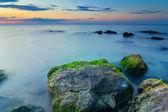 Evening stony sea coast — Stock Photo