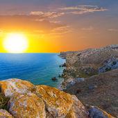 Rocky sea coast at the sunset — Stock Photo