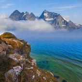 Mountains beyond a sea — Stock Photo