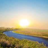 Quiet sunset over an steppe river — Stock Photo