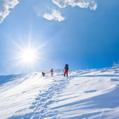 Tourist ascent winter mountain — Stock Photo