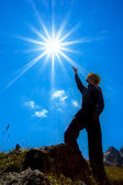 Man silhouette under a sparkle sun — Stock Photo