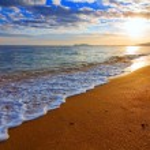 Sandy sea beach at the sunrise — Stock Photo #34202631