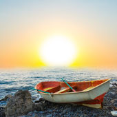 Small boat on a sea cost at the morning — Stock Photo
