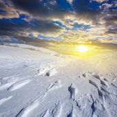 Sunset over a winter plains — Stock Photo