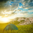 Green touristic tent in a mountains — Stock Photo