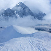 Winter mountains in a blue mist — Stock Photo