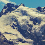 Mount peak and a glacier — Stock Photo