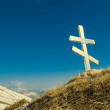 Old christian cross on a hill slope — Stock Photo