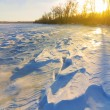 Stock Photo: Sunset over snowbound fields