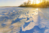 Sunset over a snowbound fields — Stock Photo