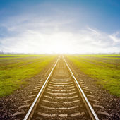 Railway leawing far to a sunrise — Stock Photo
