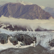 Glacier in a misty mountains — Stock Photo #44691345