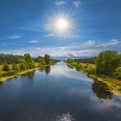 Beautiful river in a rays of sun — Stock Photo