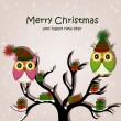 Christmas card with owls on tree — Vector de stock #12898362