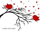 Loving pair of birds on a branch — Stock Vector